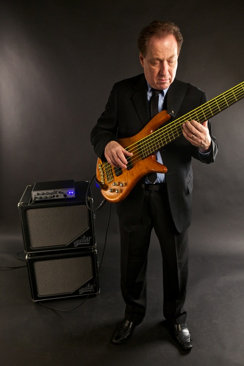 Oscar Stagnaro studio shot of him playing his electric bass.