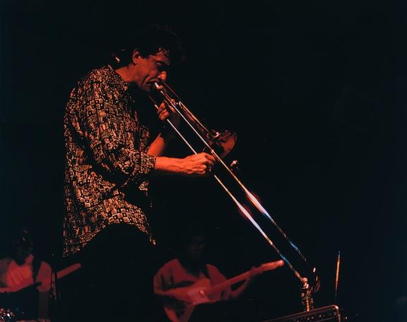 Michael Davis playing his trombone in live concert.